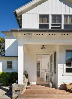 farmhouse porch by Simpson Design Group Architects