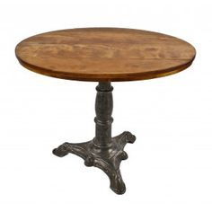 completely refinished late 19th century antique american industrial stationary three-legged cast iron pub table with original oval-shaped hardwood tabletop
