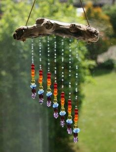 Made from a tree branch and plastic beads.