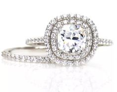 Gorgeous 1.25ct round brilliant lab created simulated diamond engagement ring with a .75ct halo and pave' band. Matching wedding wedding band included. Diamonds: 2.00 ctw Color: E Clarity: VVS1 Metal: