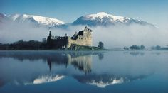 The view across the calm waters of Loch Awe to the ruins of Kilchurn Castle, with the snow dusted hills beyond