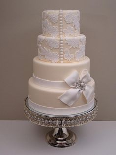 Lace Wedding Cake with Button Details.