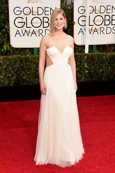 Rosamund Pike Cutout Dress - Rosamund Pike took a daring turn on the Golden Globes red carpet in a cleavage-baring white cutout gown by Vera Wang.