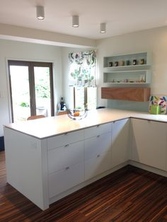 """New Zealand home. Custom kitchen remodel designer's own kitchen. Hardware by Blum, counter by Caesarstone; """"Frosty Carina"""", cabinets in lacquer finish; 1/4 Sandfly Point by Dulux, handle pulls by Hettich, negative detail; meranti"""