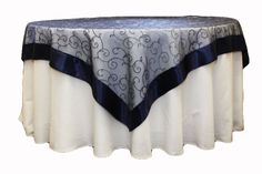 Google Image Result for http://www.cvlinens.com/images/products/table-overlay-topper/embroidery/72-embroidery-overlay/navy72embl.jpg