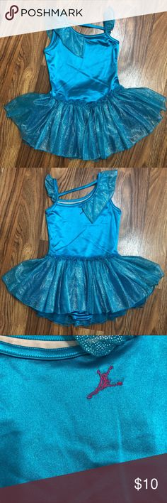 Future Star by Capezio Skirted Leotard NWOT! Future Star by Capezio skirted Leotard for girls, size small. Never worn. Beautiful shiny aqua blue bodice with sparkle accents on ruffles and skirt. Double layer skirt for extra fluff. Asymmetrical strap across back connects shoulder straps. Pink embroidered logo at upper center back. Pictures don't do this one justice. It's so pretty!! 😍 Capezio Costumes Dance