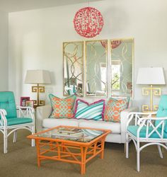 Gorgeous sun room! Turquoise and orange: a vivid interior