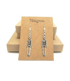 Ghost Earrings, Halloween Earrings, Ghost Jewellery, Halloween Jewellery, Halloween Jewelry, Spooky Earrings, Halloween Costume Jewellery These are a long pair of charm earrings shaped like a Skeleton. They would make a perfect addition to a Halloween Costume!The charms are Silver Plated, and measure approx 4cm from top to bottom.The earrings are on silver plated hooks and dangle down about 6cm from the earlobe.A rubber back will also be provided to hold them in place.The earrings will...