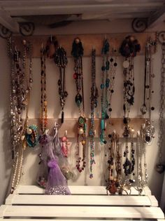 I cut a 4 foot hat rack in two and put 10 hooks in each.  Decorated it and placed it in an empty space in my closet.  Great way to store necklaces and bracelets and so easy to pick my jewelry out when I am in a hurry.