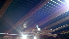 Drop Ceiling Tiles placed without a grid between the joists.