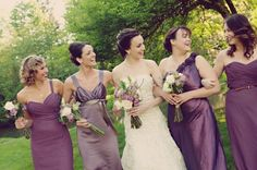 Variety of purple bridesmaid dresses- ranging in shade and material.