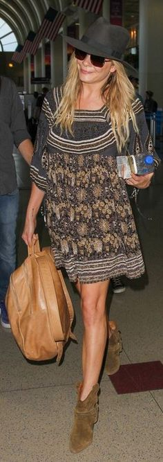 Who made LeAnn Rimes' tan leather backpack and suede ankle boots?