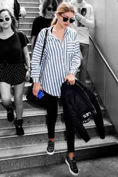 Gigi Hadid Wears A $61 Boyfriend Shirt From ASOS  #refinery29  http://www.refinery29.com/gigi-hadid-boyfriend-shirt-outfit#slide-1  Update: Gigi Hadid was not wearing Joe Jonas' striped shirt for a cross-country flight to Los Angeles. She was wearing a boyfriend shirt from ASOS, with skinny jeans and kicked-up slip-on sneakers by Giuseppe Zanotti. ...