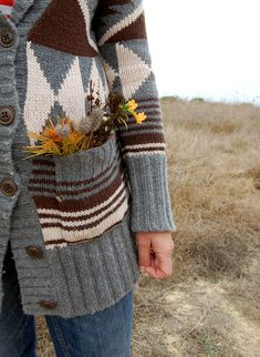 sweater with big pockets for gathering things. (not so much the big geometric patterning)
