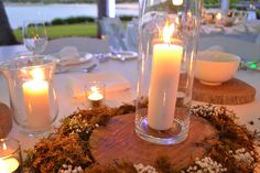 Wood block, candles, moss, babies breath, enchanted garden, centrepeice