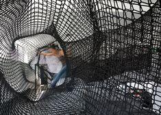 "Tube net installation designed as a ""giant convulsing centipede""."