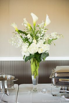 High end wedding. White reception table arrangements. Calla lilies, orchids, hydrangeas, roses. Wedding decoration ideas. Wedding photography ideas.