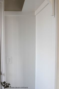 New Mudroom Planking by The Wood Grain Cottage  v- groove paneling sold at Home Depot.