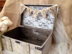We have taken a beautiful ivory card box and have added lace and twine as a backdrop to the Cards burlap banner.   The box measurements are:  13 3/8 X 8 3/8 X 7 3/4  The box will hold between 75 - 100 cards.  Please note:  Instead of the burlap cards sign banner you can elect to have the cards fram