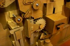 "Wow! A complex machine made almost entirely out of cardboard.  It has cardboard gears and cardboard pulleys, cardboard levers and cardboard buttons.  This could spark the imagination. Makes me think of a time machine. Don't miss the video of it in action (Click the ""Make""  link below the picture)."