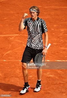Alexander Zverev of Germany celebrates during the Men's Singles third round match against Dominic Thiem of Austria on day seven of the 2016 French Open at Roland Garros on May 28, 2016 in Paris,...