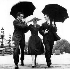 © Richard Avedon - Suzy Parker with Gardner McKay and Robin Tattersall.    Dress by Dior, Pont Alexandre III, Paris, August 1956. S)
