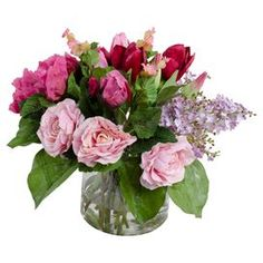 """Add a touch of garden-chic style to your decor with this lovely faux mixed floral arrangement, showcasing lush blossoms nestled in a timeless glass vase.   Product: Faux floral arrangement Construction Material: Polyester, glass, plastic, wire and acrylicColor: Pink, purple and greenFeatures:  Includes faux floralsMouth-blown vaseHand-assembled in the USADimensions:  11"""" H x 12"""" DiameterCleaning and Care:  If glass becomes cloudy, swish soapy water around, then pour out and rinse with ..."""