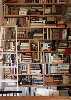 Month of sundaes- Love this Messy Bookcase with stuff everywhere...