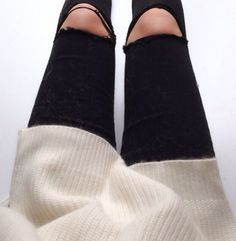 Black ripped jeans and white really cute sweater, I so need to try that out it looks adorable!