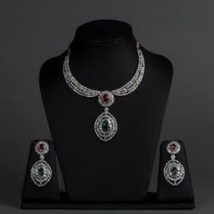Featuring this american diamonds & ruby necklace set with green stones in our wide range of Sets. Grab yourself one. Now!