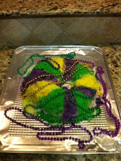Cinnamon, Pecan, and Cream Cheese Filled King Cake Recipe!!