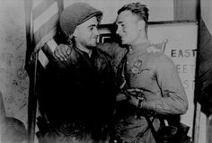 Soviet and American soldiers embrace on Elbe Day, 1945
