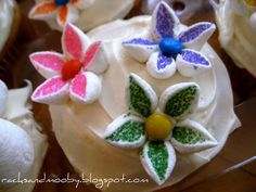 This made cute flower cupcakes for school 6th birthday. Used large marshmallows for one large flower on top.