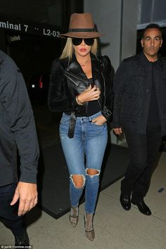 Khloe Kardashian wearing Porsche Design by Carrera 5621 Aviator Sunglasses, Yeezy Season 3 Mesh Ankle Boot Bone and Good American Knees Ripped Skinny Jeans