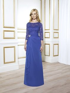 Val Stefani Style MB7411 A chantilly lace bateau bodice features 3/4 sleeves on this trumpet silhouette. The faux brooch accentuates the asymmetric waist and cascade skirt.