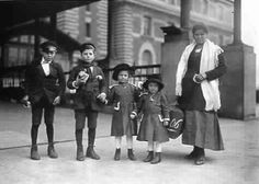 italian immigrants in the 1800s | Italian Mother and her Children arriving at Ellis Island about 1910