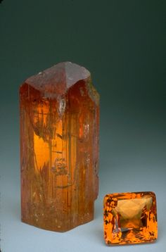 """Imperial Topaz. Until the 1950s, topaz was known almost exclusively as a yellow to golden gemstone. But the routine radiation and heat treatment of pale-colored topaz to turn it shades of blue has changed the public's perception of this gem to that of an affordable blue gemstone. Highly prized """"imperial topaz"""" is an intense golden to reddish-orange color and is found primarily at Ouro Preto, Brazil. The imperial topaz crystal and gem pictured here weigh 875.4 and 93.6 carats respectively."""