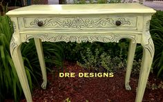 Andrea Guerriero - DRE DESIGNS - www.dredesigns.ca  facebook.com/dredesigns.ca Fabulous hall table done in Annie Sloan English Yellow as a custom mix with Pure White... 2:1 ratio of Pure White:English Yellow