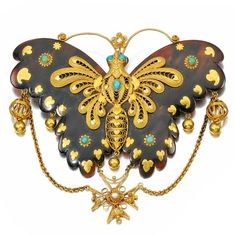 Gold and gem set brooch, 1870's, Designed as a butterfly, the tortoiseshell wings are applied with fine gold filigree work, highlighted with cabochon turquoise  seed pearls.