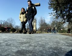 Iowa State University students walk carefully along an icy sidewalk in front of the ISU Memorial Union Building after a morning of freezing rain on Tuesday. Photo by Nirmalendu Majumdar/Ames Tribune http://www.amestrib.com/news/20170110/slick-roads-cause-crashes-around-ames-schools-delayed