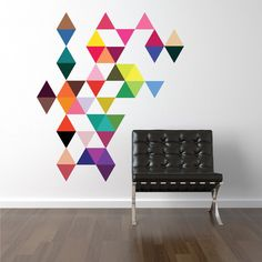 45 mod multi-color triangle adhesive fabric wall decals. Removable, repositionable and reusable. Our triangle art wall decals add beautiful bright modern colors to your walls! Infinitely arrangeable a