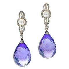 Edwardian Briolette Amethyst Pearl Diamond Platinum Earrings   From a unique collection of vintage dangle earrings at https://www.1stdibs.com/jewelry/earrings/dangle-earrings/