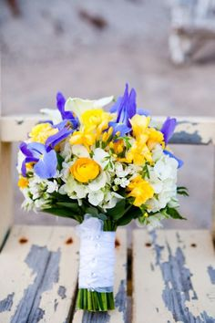 Yellow and Blue Flowers.  Flowers of Charlotte loves this!  Find us at www.charlotteweddingflorist.com