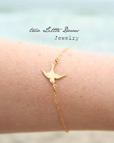 Gold bracelet. I know it's called two little doves, but this looks like a swallow to me, and I love it.