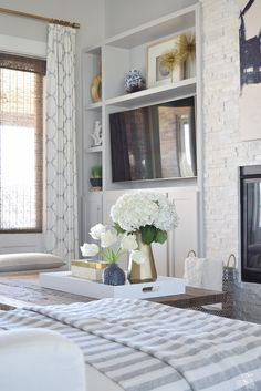 zdesign at home spring tour west elm blue patterned vase brass faceted vase white acrylic tray coffee table styling bone box white hydrangeas and tulips-3