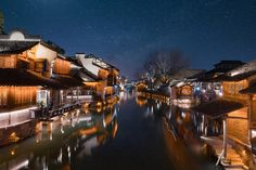 City on a canal by night (China) by bxtong chan / 500px