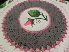Circle ruler and decorative stitching.