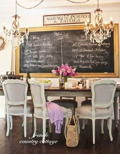 FRENCH COUNTRY COTTAGE: A Little Bit of Bling. Dining table has natural wood top and painted apron and legs with painted and upholstered chairs. Love the framed chalkboard on wall, too. French Country Dining, French Country Cottage, French Country Style, Country Cottages, Country Kitchen, Cottage Style, Country Bathrooms, Rustic French, Chic Bathrooms