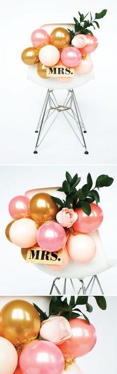 Creative balloon bride & groom chair using pink, gold and peach balloons. How to blog post -> http://www.luftblog.com/new-blog-avenue/2015/6/10/yv7xujhqtfv3qbp6hjhwp02p2xmgbu