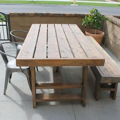 This Shanty 2 Chic outdoor patio table turned out beautifully with a weathered gray and mahogany finish to give it a rustic look.
